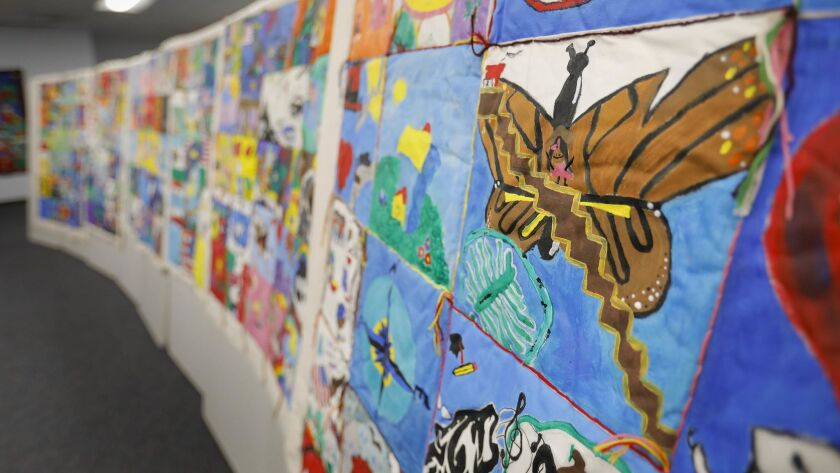 Each refugee and immigrant student graduating from the English Language Development program in June at Hoover High School created a quilt square expressing their feelings about their journey to America.