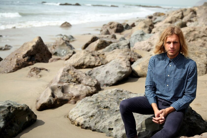 """This March 11, 2014 photo shows musician Aaron Bruno of Awolnation in Malibu, Calif. Awolnation's haunting song, """"Sail,"""" has sold 5 million tracks and the sleeper hit is the second longest running song on the Billboard Hot 100 chart with 79 weeks. The band is currently working on the follow-up to their gold-selling 2011 debut, """"Megalithic Symphony.""""(Photo by Matt Sayles/Invision/AP)"""