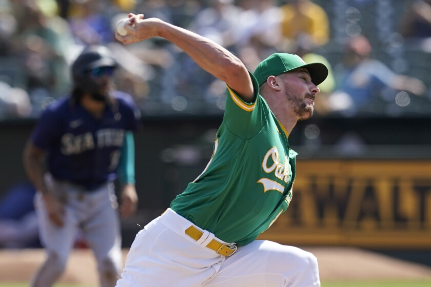 Oakland Athletics' Chris Bassitt pitches against the Seattle Mariners during the first inning of a baseball game in Oakland, Calif., Thursday, Sept. 23, 2021. (AP Photo/Jeff Chiu)