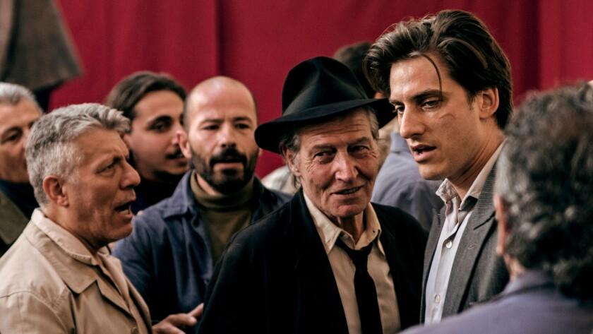 """Carlo Cecchi and Luca Marinelli in the movie """"Martin Eden."""""""