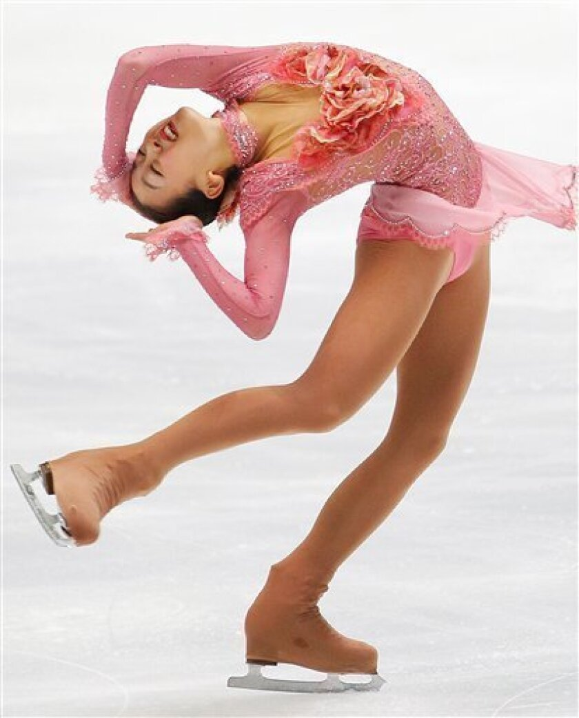 FILE - In this Dec. 26, 2009, file photo, Mao Asada of Japan, performs in the ladies short program event at the Japan National Figure Skating Championships in Osaka, western Japan. (AP Photo/Itsuo Inouye, File)