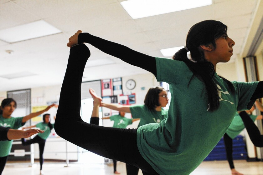 Eighth-grader Lydia Lopez practices contemporary dance at Gabriella Charter School, which has been attracting attention for the high achievement of its students.