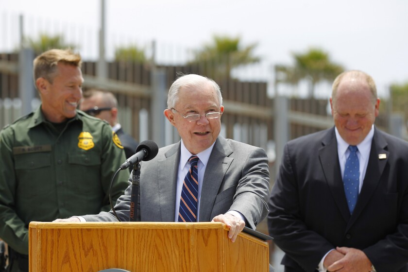 Attorney General Jeff Sessions speaks at a news conference at Border Field State Park with Tijuana, Mexico, behind him on Monday, May 7, 2018, in San Diego, Calif.
