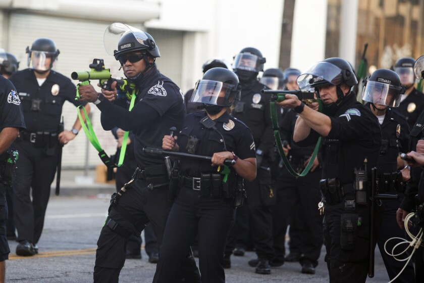 FILE - In this May 30, 2020, file photo, police aim weapons on demonstrators protesting the death of George Floyd, in Los Angeles. Police unions and other law enforcement organizations went into overdrive in the final days of the Legislature's annual session, thwarting a bill that would have added California to the majority of states that can end the careers of officers with troubled histories. (AP Photo/Ringo H.W. Chiu, File)