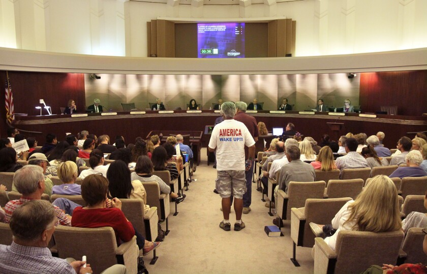 Speakers for and against a proposed immigrant children's shelter in Escondido wait to speak at the Escondido City Council meeting held in October, 2014