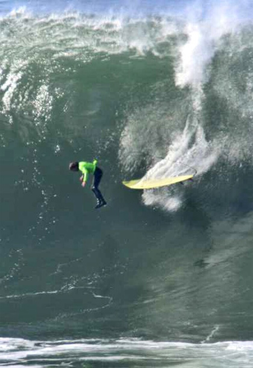 WIPEOUT: Grant Baker of South Africa is worked by the waves. Two dozen surfers challenged one of the world's most dangerous breaks at Mavericks, about 20 miles south of San Francisco.