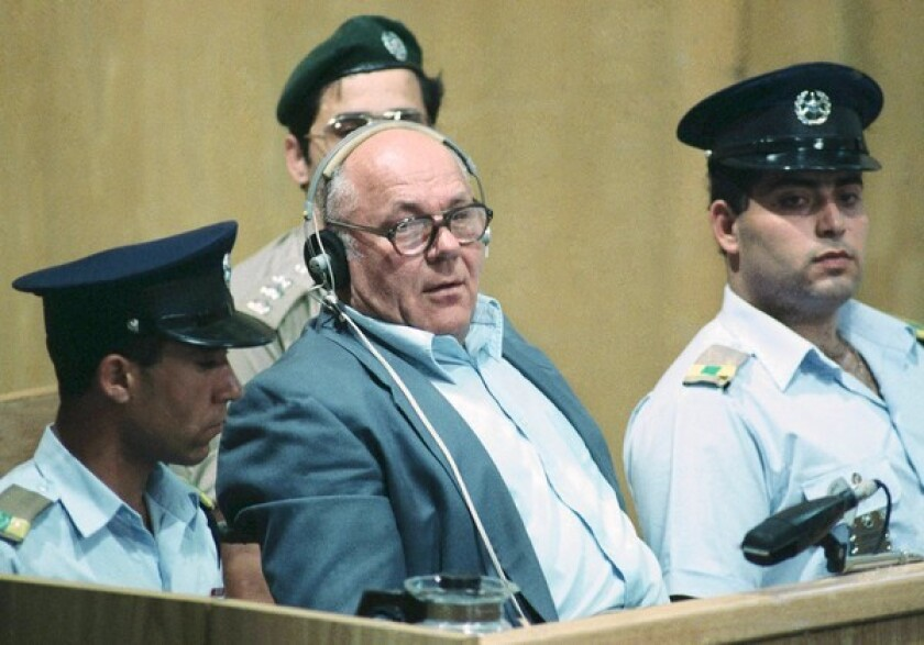 John Demjanjuk, accused of war crimes against humanity, sits in the dock of Israel's supreme court in Jerusalem while being sentenced in April 1988.