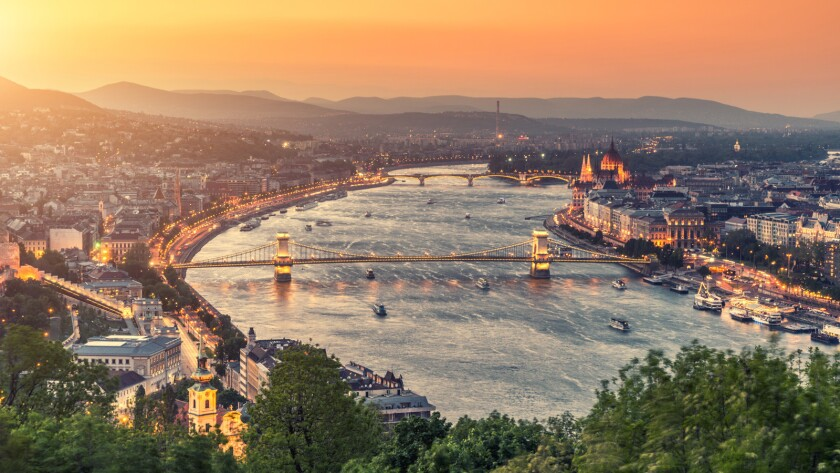 The Danube River flows past the Parliament building and Chain Bridge in Budapest, Hungary, one of 10 countries the river snakes through on its 1,770-mile journey.