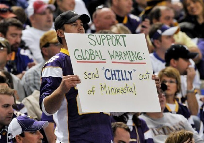 A Minnesota Vikings fan fan holds up a sign calling for the firing of head coach Brad Childress during an NFL football game between the Vikings and the Arizona Cardinals, Sunday, Nov. 7, 2010, in Minneapolis. Childress has taken heat for releasing wide receiver Randy Moss after less than a month with the team. (AP Photo/Jim Mone)