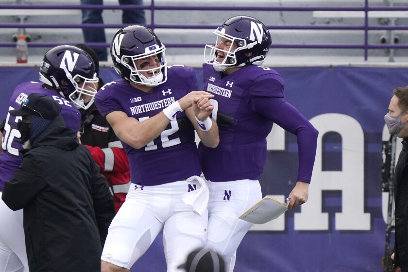Northwestern's Peyton Ramsey celebrates with Carl Richardson during a game against Wisconsin.