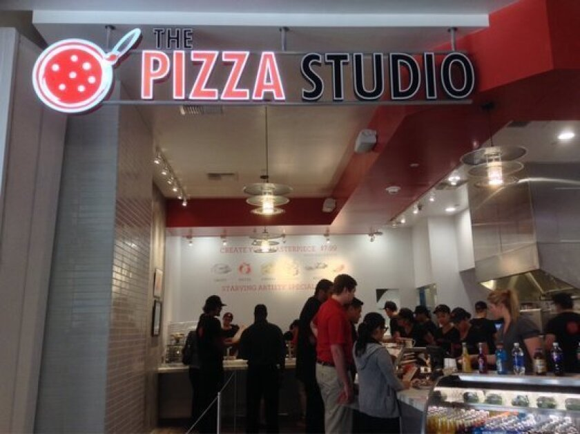 The Pizza Studio, based in Los Angeles, is expanding to San Diego with 20 new locations in the next five years. This Sept. 24, 2013 photo shows the storefront of one of the chain's downtown Los Angeles locations.