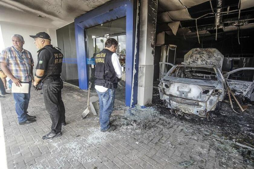Police gather evidence on Jan. 5, 2019, at a bank destroyed by a bomb blast the day before in Fortaleza, Brazil. EFE-EPA/ Jarbas Oliveira