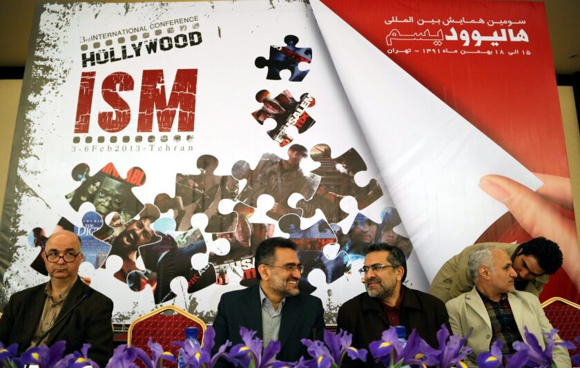 """Iranian Culture Minister Mohammad Hosseini, center, talks with Javad Shamaghdari, deputy cultural minister for cinema affairs, at the """"Hollywoodism and Cinema"""" conference in Tehran on Sunday."""