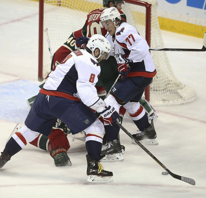 Washington Capitals left wing Alex Ovechkin works the puck against the Minnesota Wild during the second period of an NHL hockey game, Wednesday, Feb. 11, 2016 in St. Paul, Minn. (Elizabeth Flores/Star Tribune via AP)  MANDATORY CREDIT; ST. PAUL PIONEER PRESS OUT; MAGS OUT; TWIN CITIES LOCAL TELEVIS