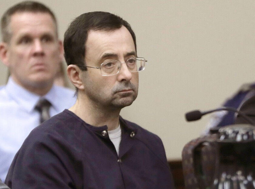 """FILE - In this Jan. 24, 2018, file photo, Larry Nassar, a former doctor for USA Gymnastics and member of Michigan State's sports medicine staff, sits in court during his sentencing hearing in Lansing, Mich. The FBI made numerous serious errors in investigating allegations against former USA Gymnastics national team doctor Larry Nassar and didn't treat the case with the """"utmost seriousness,"""" the Justice Department's inspector general said Wednesday, July 24, 2021. The FBI acknowledged conduct that was """"inexcusable and a discredit"""" to America's premier law enforcement agency. (AP Photo/Carlos Osorio, File)"""