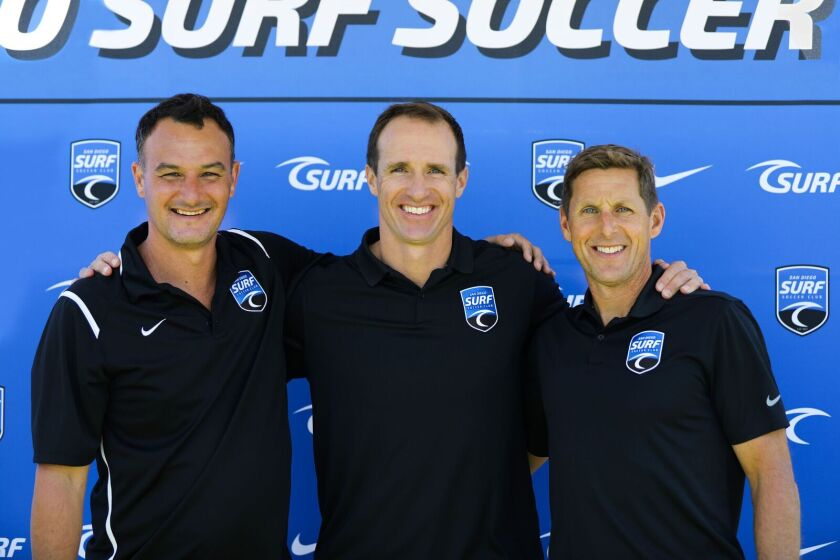 Drew Brees (center) pictured with Surf Sport's National Sporting Director Josh Henderson and CEO Brian Enge