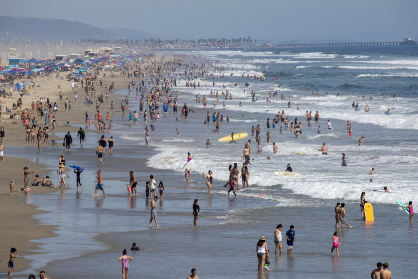 Huntington Beach is crowded with beachgoers last month. The city will close the beach for the July 4 holiday.