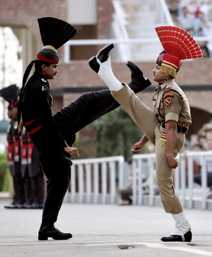 An Indian Border Security Force soldier, right, and Pakistani Ranger soldier conduct an elaborate march during the daily flag ceremony at the Wagah border post.