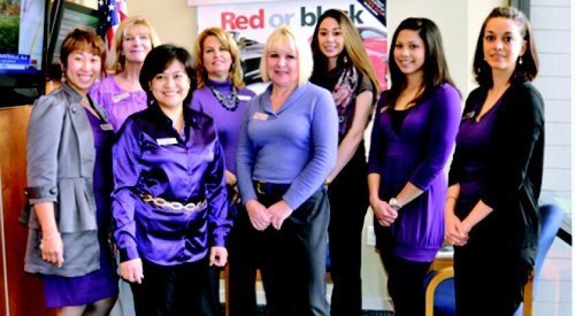 Del Mar's Navy Federal Credit Union staff members wearing purple show their support for military families.
