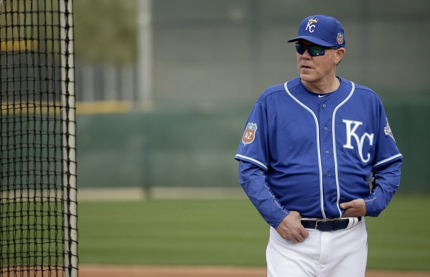 FILE - In this Feb. 19, 2016, file photo, Kansas City Royals manager Ned Yost watches workouts during spring training baseball practice in Surprise, Ariz. The Royals believe they can win a second straight World Series title. (AP Photo/Charlie Riedel, File)