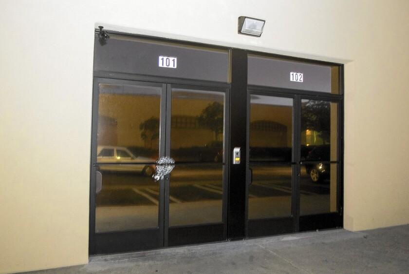 The door is chained after Costa Mesa police raided a Harbor Boulevard storefront that they believed was a marijuana dispensary but a lawyer says is a new location of Oklevueha Native American Church.