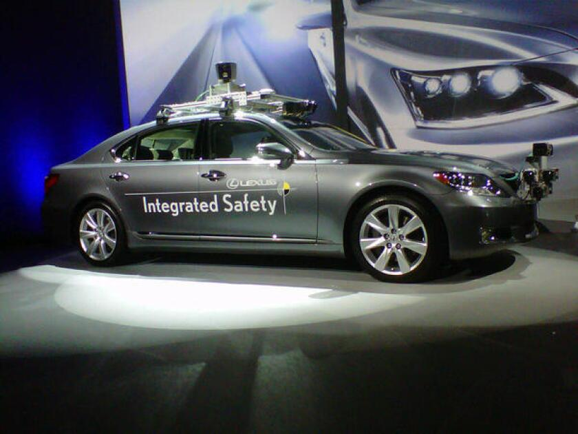 Lexus shows off its driverless car concept at CES 2013.