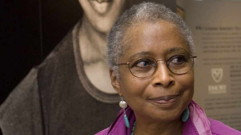 In this April 23, 2009 file photo, Alice Walker stands in front of a picture of herself from 1974 as she tours her archives at Emory University, in Atlanta.