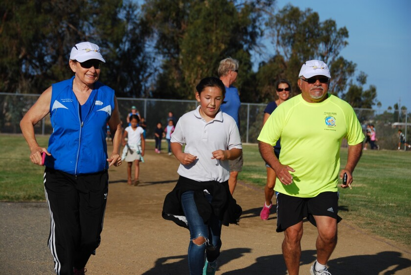 Event organizer Kathy Kinane and state Assemblyman Rocky Chavez ran with the Mileage Club at Laurel Elementary in Oceanside recently. They kicked off a conditioning program for the kids and families who plan to run in the O'side Turkey Trot on Thanksgiving Day this year.