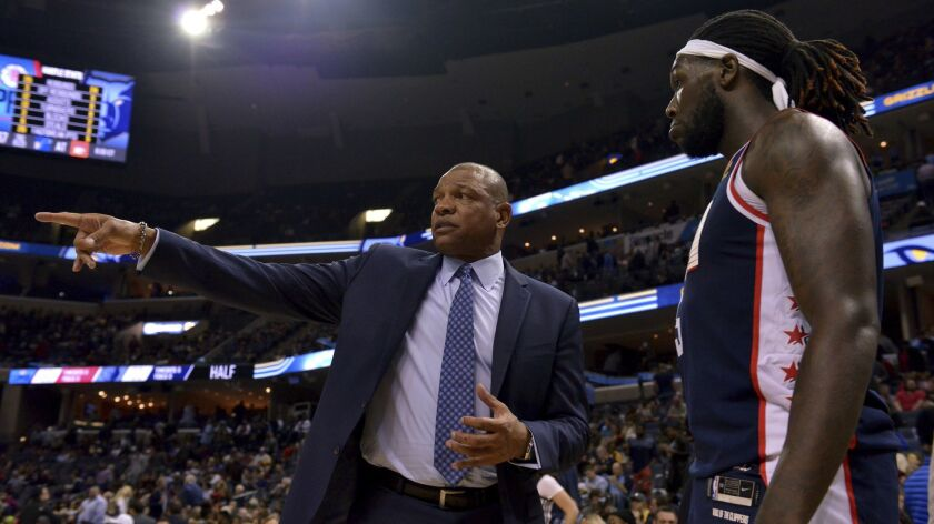 Los Angeles Clippers head coach Doc Rivers, left, talks with forward Montrezl Harrell after the firs