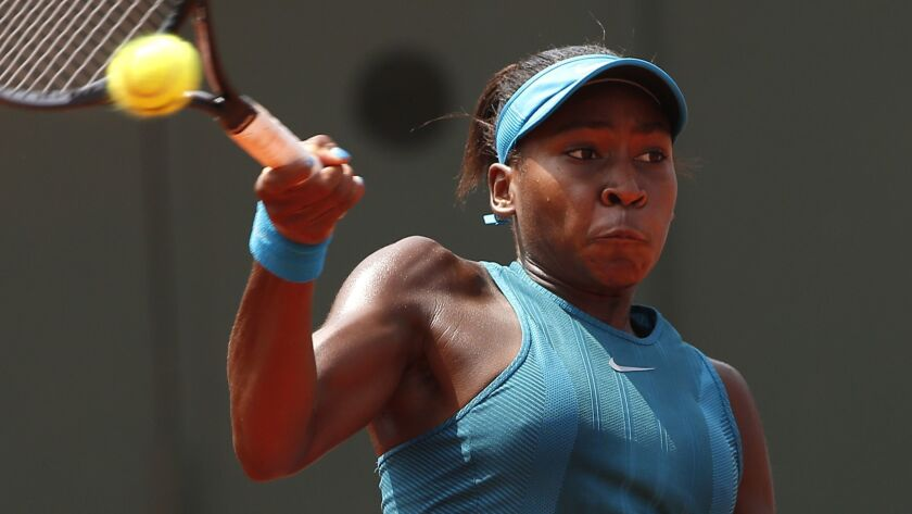 FILE - In this Saturday, June 9, 2018 file photo, Cori Gauff of the U.S returns the ball to compatri
