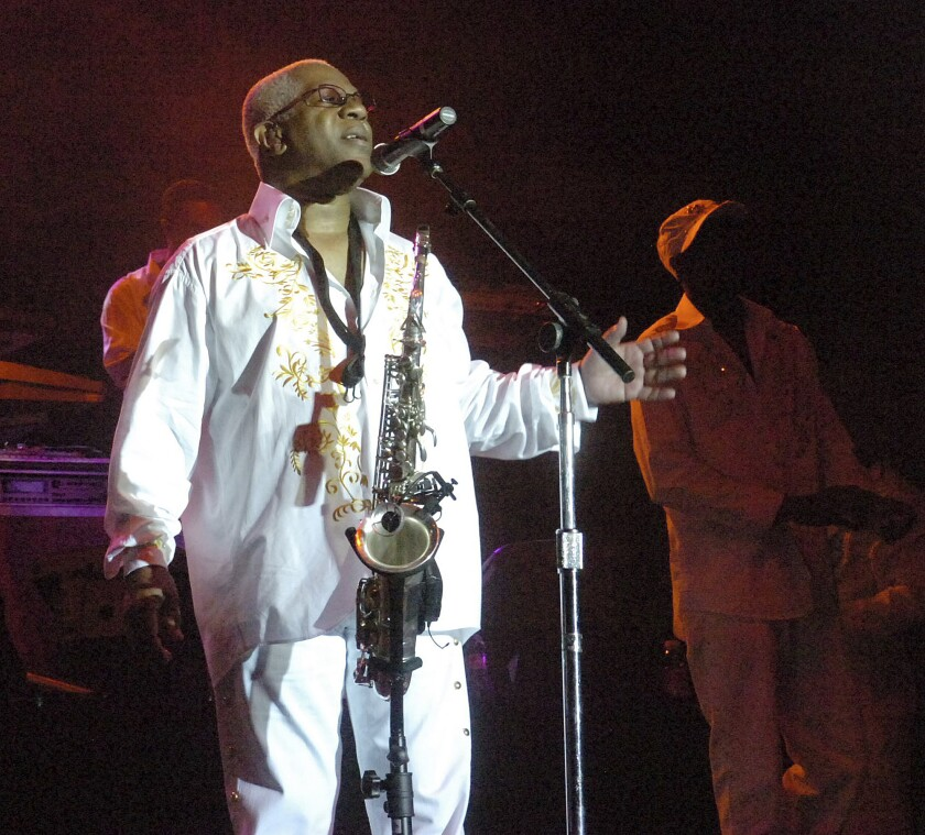 """FILE - In this Aug. 3, 2008 file photo, Dennis Thomas performs with the band """"Kool and the Gang"""" in concert in Bethlehem, Pa. Dennis """"Dee Tee"""" Thomas, a founding member of the long-running soul-funk band Kool & the Gang, has died. Thomas died peacefully in his sleep Saturday, Aug. 7, 2021 in New Jersey, where he was a resident of Montclair.(Joe Gill/The Express-Times via AP)"""