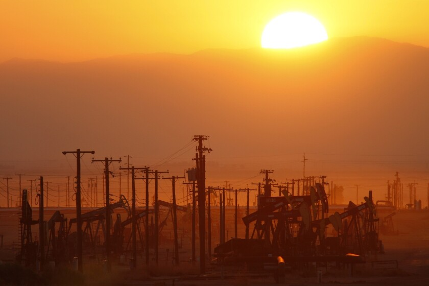 The sun rises over an oil field at the Monterey Shale formation in March 2014 where gas and oil extraction using hydraulic fracturing, or fracking, is on the verge of a boom near Lost Hills, Calif.