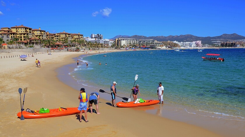 MEXICO, CABO SAN LUCAS: Medano Beach, Cabo San Lucas, is a hub of daytime activities from waterspout