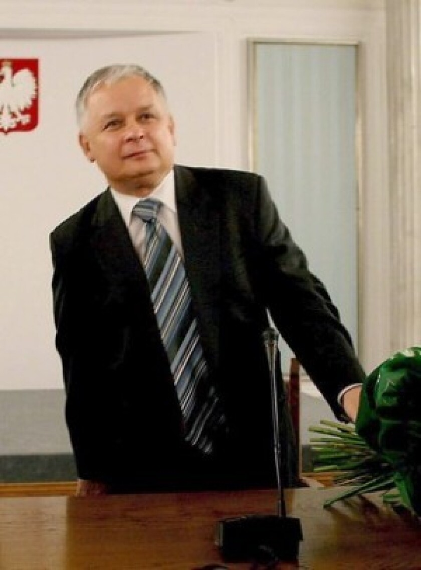 Polish President Lech Kaczynski, right, who died in a plane crash Saturday, and his twin brother, Jaroslaw, led their nation rightward.