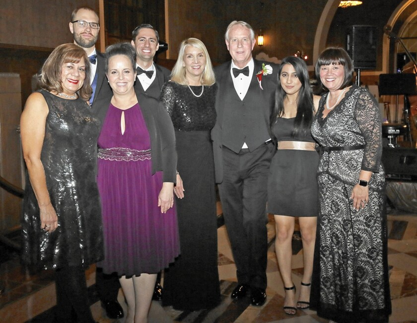 """The Stone-Beck Group at Morgan Stanley received the Ambassador of Hope Award at Ascencia's gala earlier this month. Picture, from left, are Celia Cocherell, Rob Stone, Christina Smith, Bryan Longpre, Nancy Stone, Senior Vice President Gene """"Chip"""" Stone, Annette Baban and Senior Vice President Toni Beck Espinoza."""