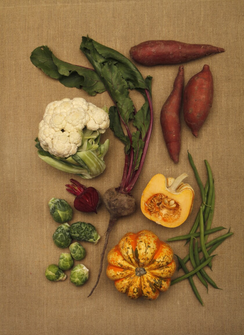 LOS ANGELES CA. NOVEMBER 5, 2014: A selection of vegetables including cauliflower, beets, brussels s
