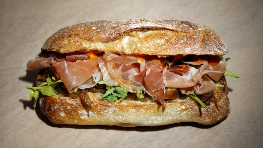 The Serrano ham sandwich, with Serrano ham, caramelized onions, arugula and brava sauce at the Tumaca food truck.