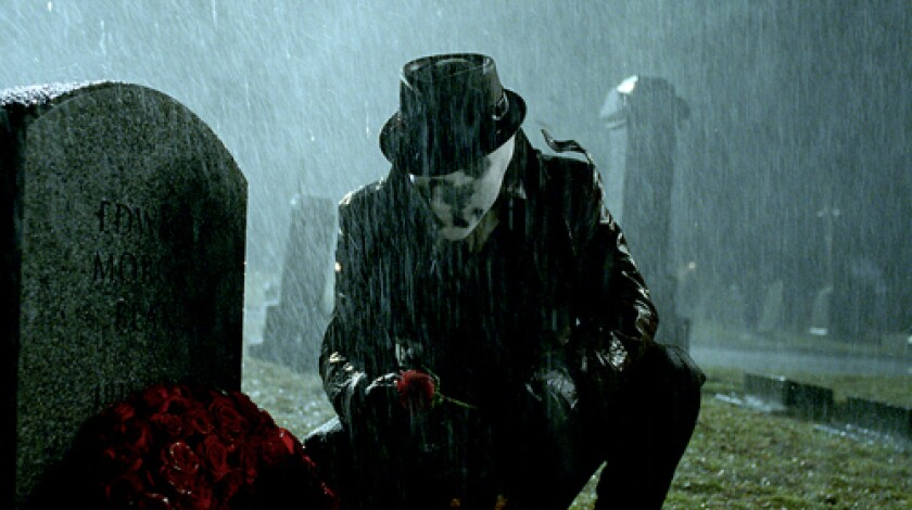 """MASKED: Jackie Earle Haley had to convey Rorschach's troubled psyche through, as he puts it, """"a sock over my head."""" While shooting this scene, Haley said he felt the character come alive."""