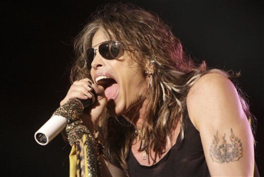 FILE - In this June 10, 2009 file photo, lead singer Steven Tyler of the rock band Aerosmith performs at the Verizon Wireless Amphitheatre in Maryland Heights, Mo. (AP Photo/Jeff Roberson, File)