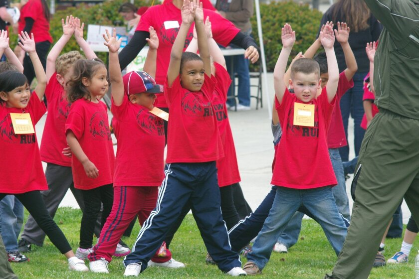 Alamosa Park Elementary School students in Oceanside participate in a warm-up exercises led by Camp Pendleton Marines.