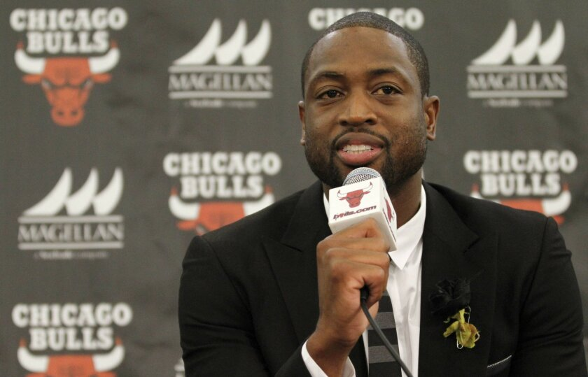 """FILE- In this July 29, 2016, file photo, Chicago Bulls player Dwyane Wade speaks during a news conference in Chicago. A family spokesman says a cousin of Wade's was fatally shot Friday, Aug. 25, while pushing a baby in a stroller on the city's South Side. Wade posted on Twitter: """"My cousin was kill"""