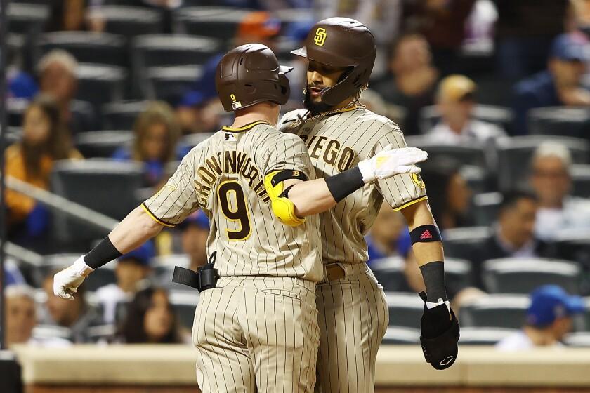Jake Cronenworth celebrates with Fernando Tatis Jr. after hitting a two-run homer
