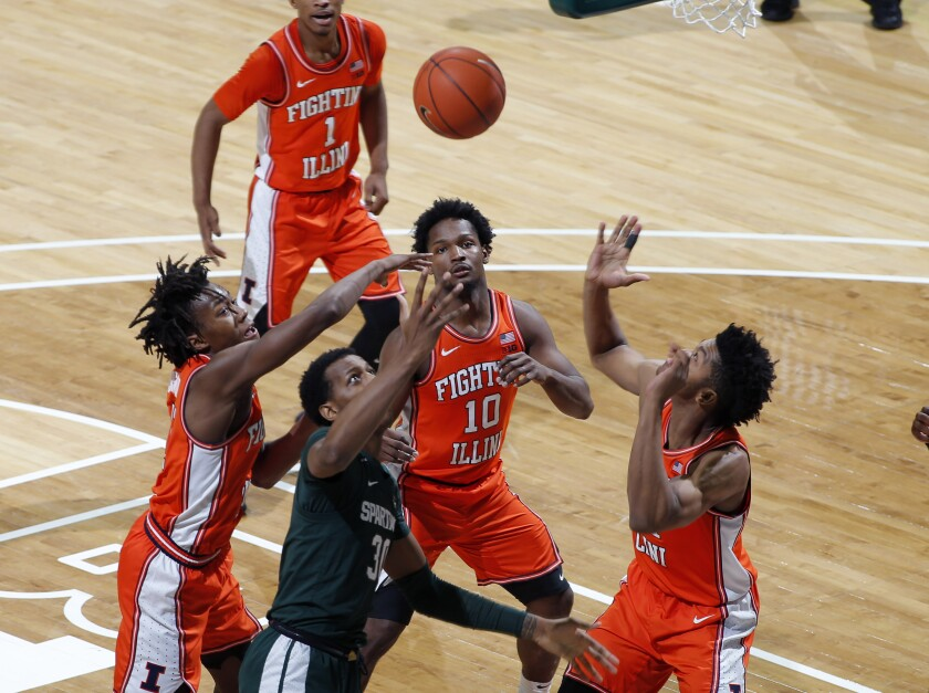 Illinois' Ayo Dosunmu, Michigan State's Marcus Bingham Jr. and Illinois' Andres Feliz (10) and Jermaine Hamlin, from left, vie for a rebound during the first half of an NCAA college basketball game Thursday, Jan. 2, 2020, in East Lansing, Mich. (AP Photo/Al Goldis)