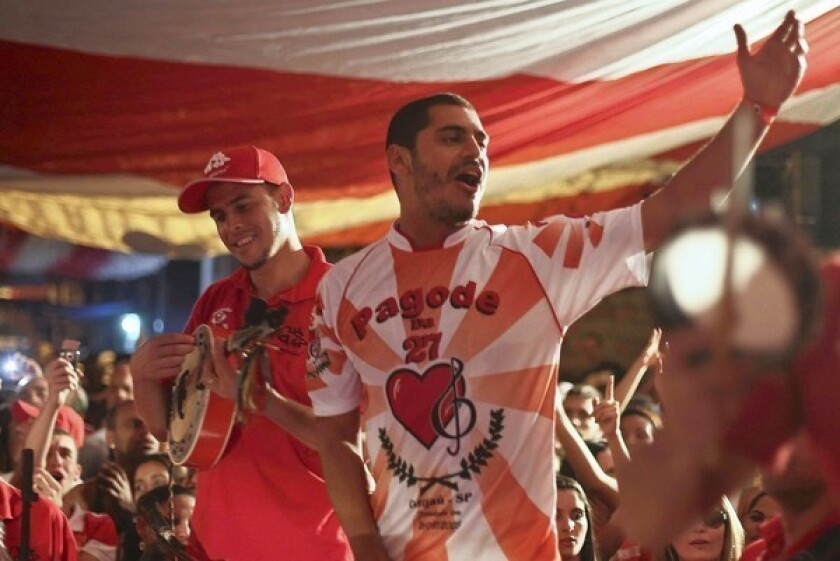 Hip-hop star Criolo, center, is leading the Brazilian rap scene's push into the spotlight, singing about poverty and corruption.
