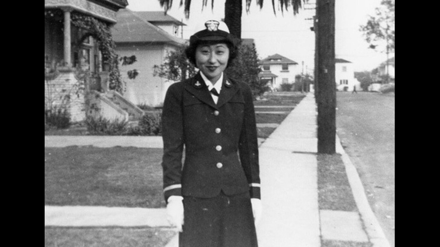 Susan Ahn Cuddy stands on the street where the Ahn family home was located between 1936 and 1946. Cuddy enlisted in the U.S. Navy in 1942. She is believed to be the first Asian American female U.S. Navy officer and became the Navy's first female gunnery officer during World War II, according to her official 2002 biography.