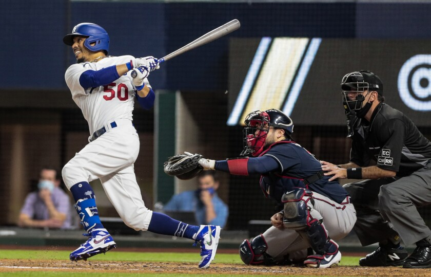 Dodgers right fielder Mookie Betts lines out during the third inning of a 5-1 loss to the Atlanta Braves.