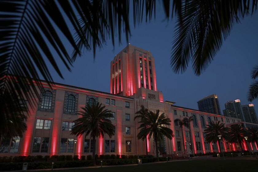 View of the County Administration Center lit-up with red light