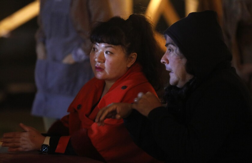 "Composers Du Yun, left, and Raven Chacon attend rehearsal for ""Sweet Land"" at Los Angeles State Historic Park on Feb. 21, 2020."