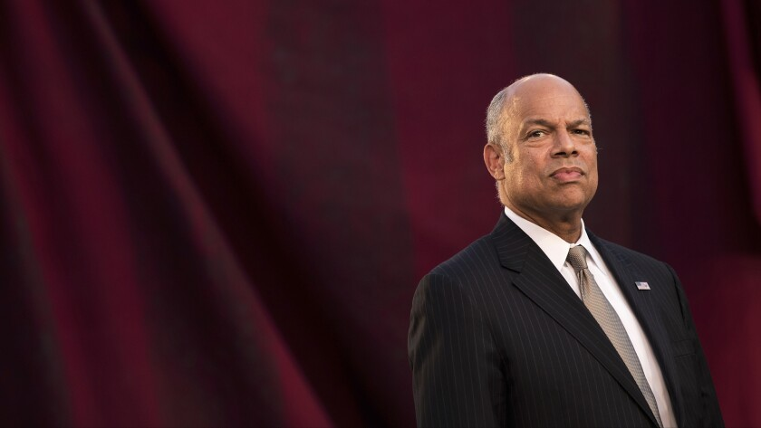 Jeh Johnson, secretary of the Department of Homeland Security, waits to swear in immigrants during a naturalization ceremony in New York.