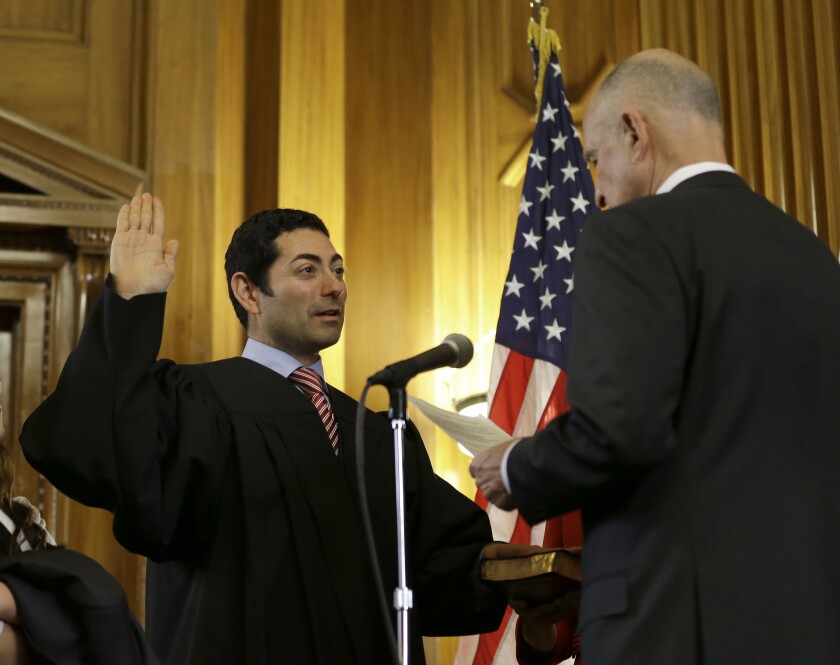 Mariano-Florentino Cuéllar, left, is sworn in as an associate justice to the California Supreme Court by Gov. Jerry Brown.